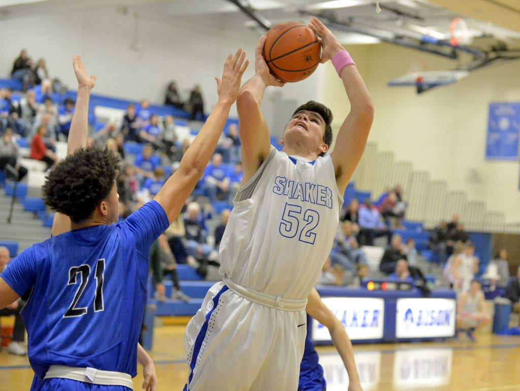 Shaker's Matt Holmes (52) shoots over a Saratoga Springs defender during a Suburban Council game Friday, Feb. 5, in Latham. Robert Goo/www.goosphotos.com