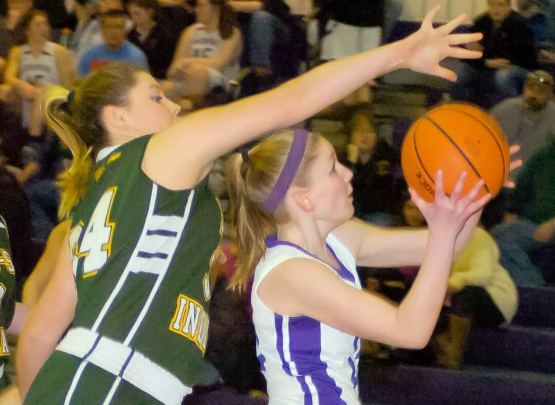 Ravena's Bailey Cross (34) tries to block Laura Patak's shot during a Colonial Council game against  Voorheesville Friday, Feb. 5. Rob Jonas/Spotlight