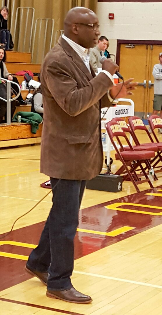 Colonie Central High School  graduate and  former Denver Broncos wide receiver David Gamble spoke to the fans at halftime of  Colonie's home game against Guilderland  Tuesday, Feb. 9. Rob Jonas/Spotlight