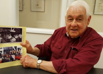 Skip Parsons shows pictures of how Riverboat Jazz Band has evolved over the decades. Rob Jonas/Spotlight