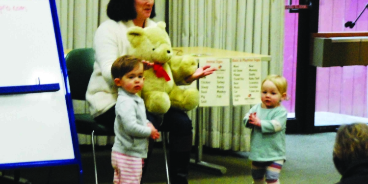 Rebecca Demarest of Happy Babble interacts with a couple of toddlers in a recent sign language class at Bethlehem Public Library.