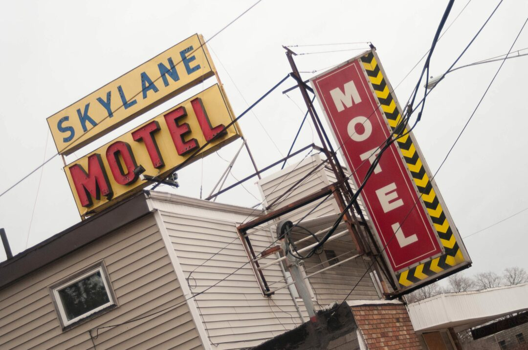 Skylane Motel remains on Central Avenue, nearly two years after investigations found the building to be in violation of hundreds of different health and safety code violations. Michael Hallisey/Spotlight