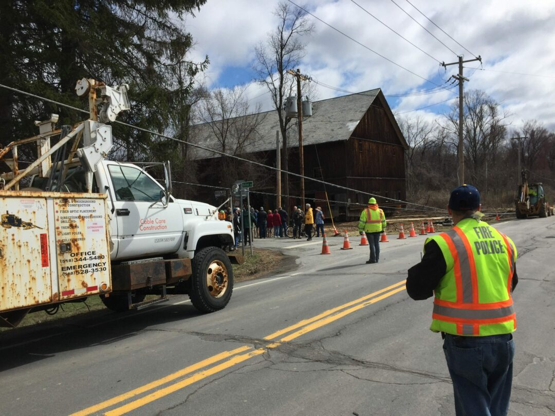 It's not everyday when you can see a 100-year old barn cross the street. Nearly 100 residents gathered to watch as the Hilton Barn did just that on Tuesday, March 29. Tricia Cremo/Spotlight