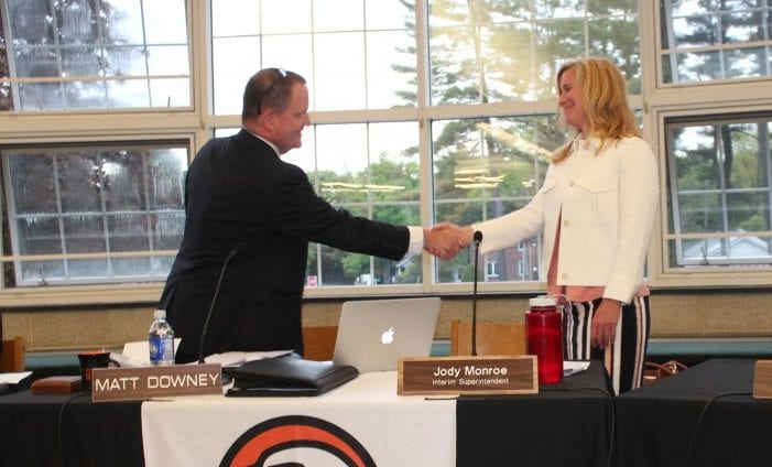 Bethlehem Central School District  Superintendent Jody Monroe shakes hands with Board of Education President Matt Downey after being officially sworn in as the district's new leader during the board's meeting on Wednesday, May 18. Tricia Cremo/Spotlight