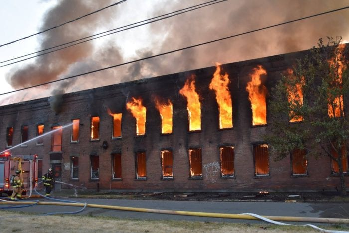 Firefighters combated against 80-degree heat and explosions, as they battled for nine hours to contain a fire that consumed a Broadway warehouse in Watervliet on Saturday, June 25. Photos by Sidewinder Photography