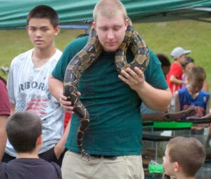 Festival-goers get to hold snakes brought by Uncharted Wild