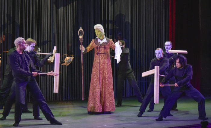 """Jarrett Porter, as The Narcissistic Ogre, is surrounded by his image in Opera Saratoga's """"The Witches of Venice."""" Gary David Gold"""