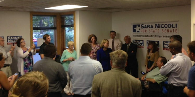 Backed by Assemblywoman Pat Fahy, Supervisor Peter Barber and Congressman Paul Tonko, Niccoli addresses supporters at her Guilderland headquarters opening. / Photo by: Gary Ginsburg