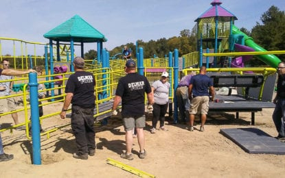 Volunteers assemble Elm Avenue Park playground
