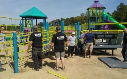 Volunteers build new Elm Ave Park playground