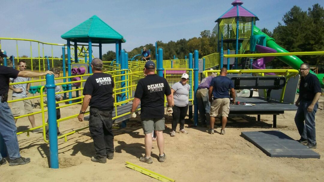 Community volunteers, including some Delmar firefighters, survey their work