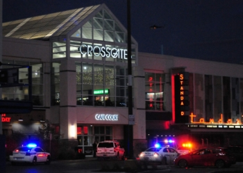Multiple police agencies remained on the scene at Crossgates Mall at dusk Saturday evening as they continue their search for a suspect in an alleged shooting which took place inside the mall earlier in the afternoon.