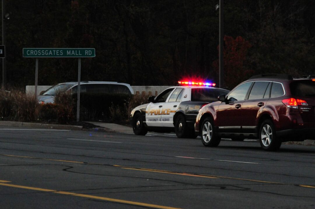 A University at Albany cruiser blocks the Western Avenue entrance to Crossgates Mall late Saturday afternoon after an alleged shooting took place.