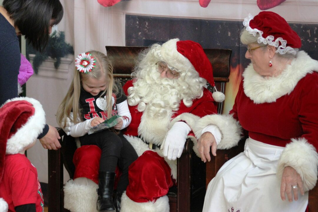 Children visit with Santa and Mrs. Claus during the Ballston Spa Business &  Professional Association's Breakfast with Santa