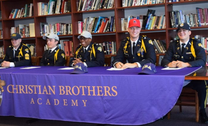 From left, CBA athletes Nolan Isabella, PJ McHugh, Amir Taylor, Davis Payne and Nick DeBrino sign their National Letters of Intent Thursday, Nov. 10. Submitted photo