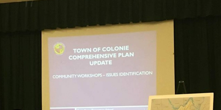 Michael Welti presents the town's Comprehensive Plan to residents at Forts Ferry Elementary School (photo by Kassie Parisi/spotightnews.com)