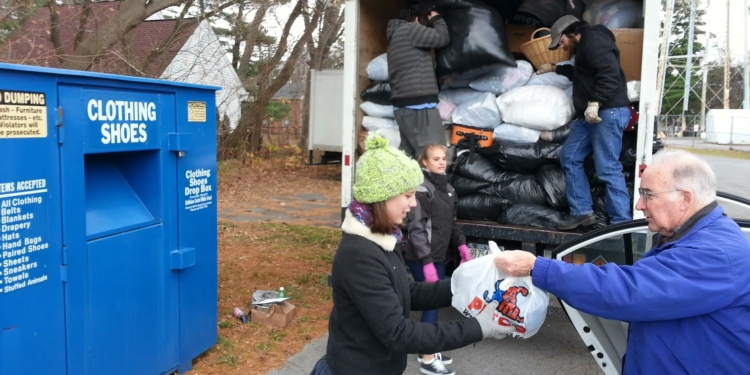 The Town of Bethlehem, BCSD Green Team and Delmar Farmer's Market are holding an America Recycles Day Collection, open to all area residents, on Saturday, November 19 from 10 AM – 1 PM at the BC Middle School parking lot, 332 Kenwood Ave, Delmar (the Farmer's Market is inside). Clothing/textiles and books will be collected for reuse and recycling, and secure document shredding is available free on-site for Town residents and BC taxpayers. Pictured: student volunteers Ella Goodwin (foreground) and Rachel Antinucci (background) help unload textiles at last year's event.
