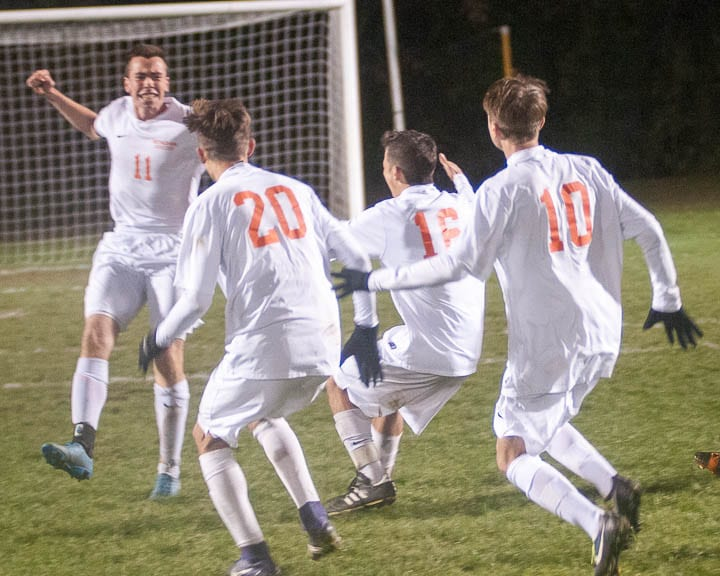 Kevin Piccolino (11) is mobbed by his teammates after he scored the winning goal in penalty kicks to lift Bethlehem past Shenendehowa in the Section 2 Class AA final. Jim Franco/Spotlight