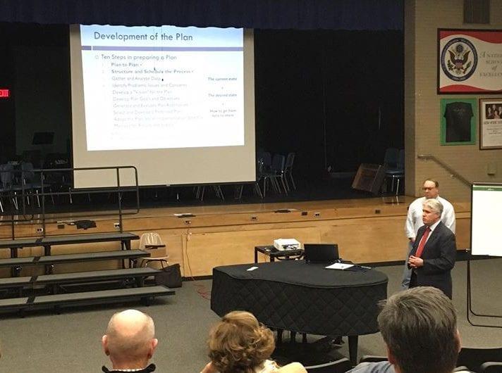 Michael Welti and Chuck Voss address the public at Shaker Junior High School on Thrusday, Dec. 1.  (Photo by Kassie Parisi/Spotlight News)