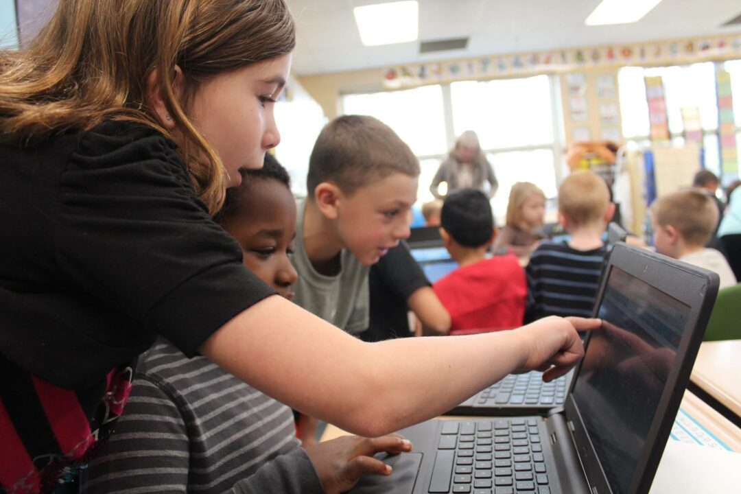 Slingerlands students in Mrs. Clarkson's fourth grade class share computer programming fundamentals - and their Chromebooks - with first graders in Mrs. McCaffrey's class during Hour of Code in early December // Photo: BCSD