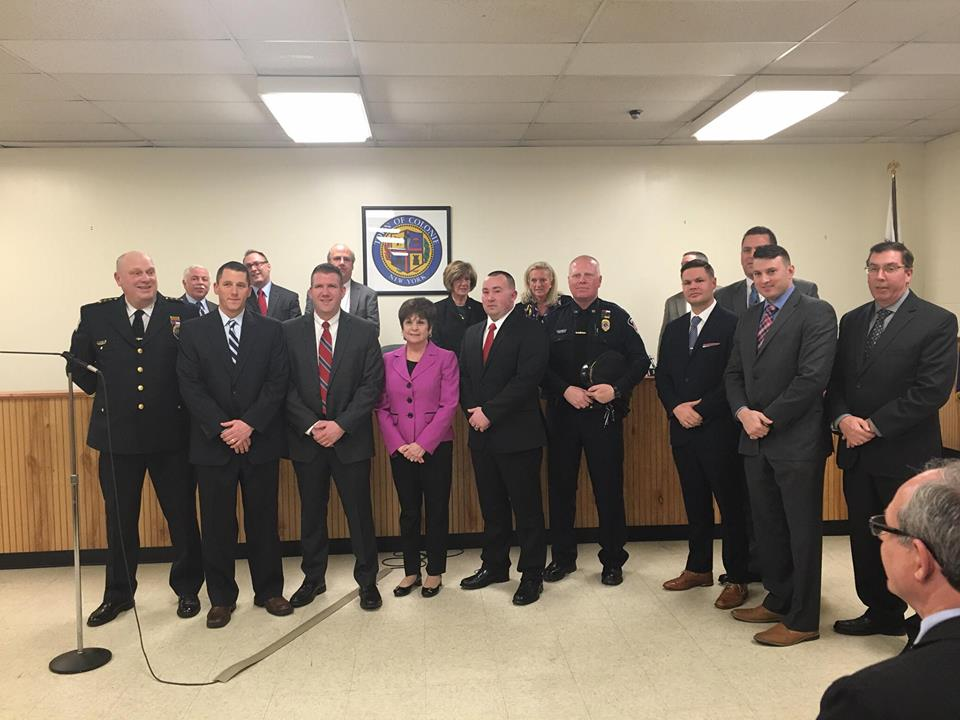 Supervisor Paula Mahan stands with the town board and members of the town's emergency response and law enforcement, services cited as reasons for Colonie being named a desirable community to live. (Photo by Kassie Parisi/Spotlight News)
