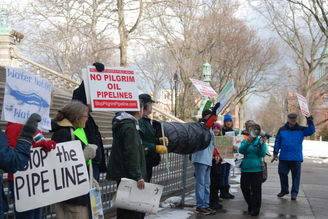 Protesters against the Pilgrim Pipeline gather at the steps of New York's Capitol Building. (Photo by Ali Hibbs / Spotlight News)