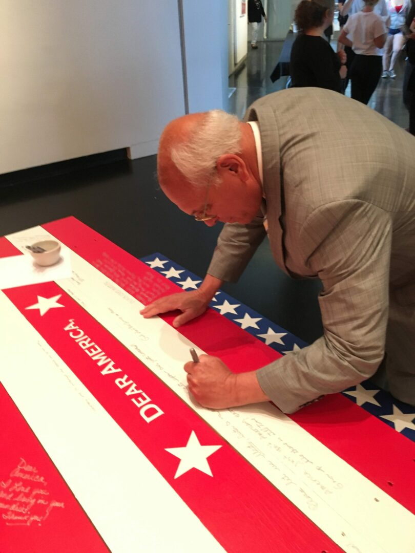 """U.S. Rep. Paul Tonko contributes to the """"Dear America,"""" project on July 9, 2016, at the Frances Young Tang Teaching Museum and Art Gallery at Skidmore College // Photo provided."""