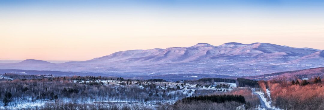 Photo by Robert Stone, showing a recent winter view of the Catskill Mountains taken from the Bolotsky Property, which was protected in 2016 by MHLC, in Rensselaerville, NY.