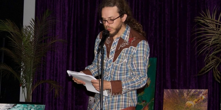 Chris Caulfield reads from his poetry. Photo submitted)