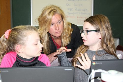 Superintendent of Schools Jody Monroe learns about the importance of technology in education from Slingerlands fifth-graders // Photo: BCSD