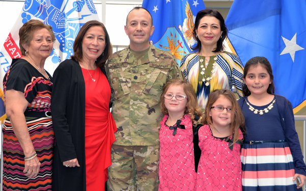 Newly-promoted Lt. Col. Luis Garcia poses for a photo after his promotion ceremony at the New York State Division of Military and Naval Affairs on Feb 3. His family members are, from left: his mother, Blanca Garcia; his wife, Nelly Garcia; his sister, Pat Garcia; his twin daughters Vienna and Sophia; and his daughter Julia (U.S. Army National Guard photo by Master Sgt. Raymond Drumsta, 42nd Infantry Division)