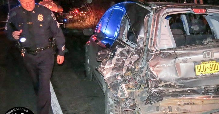 An officer inspects a Honda SUV that was involved in an accident in Glenmont (Photo by Tom Heffernan Sr.)