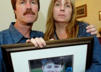 Michael and his wife Lisa hold a photo of Jonathan. Photo from the Disability Rights Project