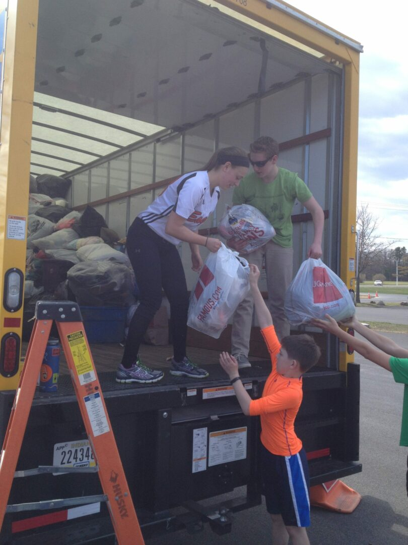 Student volunteers helping load textiles at a previous event // Photo courtesy of Town of Bethlehem