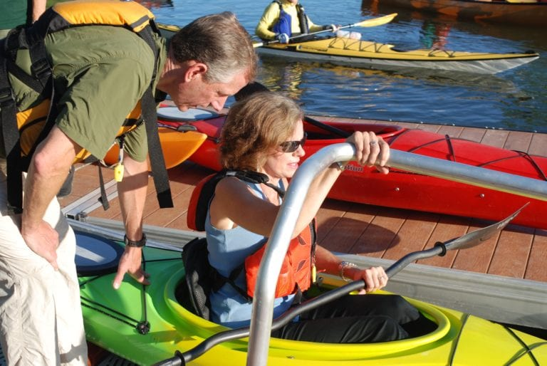 Bethlehem Supervisor John Clarkson helps Assemblywoman Pat Fahy into her kayak at the August unveiling of the new kayak launch at Henry Hudson Park in Selkirk // Photos: Ali Hibbs