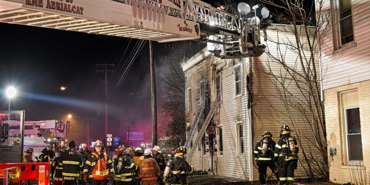 Firefighters battle a blaze on Central Avenue in the Town of Colonie (photo by Sidewinder Photography)