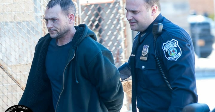 Tyler Hunt is escorted into the Bethlehem Police Department (Photo by Jim Franco/Spotlight News)