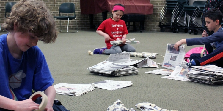 Young engineers craft chairs out of newspapers during a STEM program at the library on Tuesday, March 28.   CREDIT: Kristen Roberts