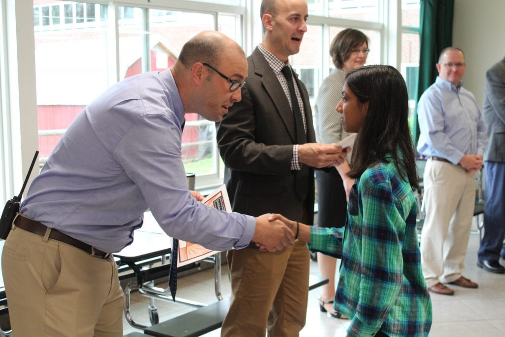 BCMS Interim Principal David Doemel congratulates Character Award recipient, 7th grader Anushka Patel // Photo submitted