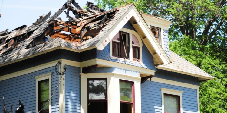 The owners of this home at 1613 New Scotland Ave. in Slingerlands say they will restore it after a lightening strike caused extensive fire and water damage // Mike Hallisey