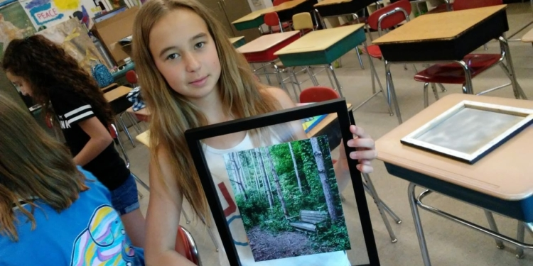 7th grader Paige Doherty has been cataloguing and framing artwork for the last two months to give other children her age the chance to get an education // Photos: W. Reilly