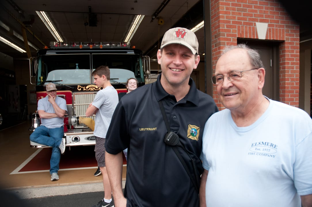 Lt. Michael Moon stands next to Wayne Johnson, a 56-year  member of Elsmere Fire Department. Both were on hand as their firehouse opened its doors to the public to entice new recruits.  Photo by Michael Hallisey / Spotlight News