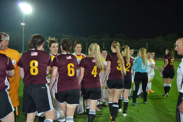 Members of the Colonie Soccer Club shake hands with rival team, Balasar, before the game begins.