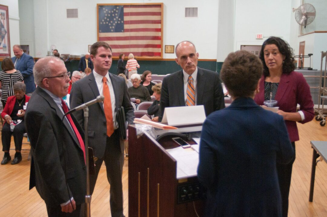Town Board candidates speak with moderator immediately before Oct. 19 forum // Photo by Michael Hallisey / Spotlight News