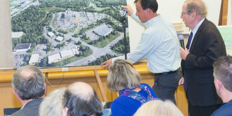 Members of the Galesi Group present the sketch plan for Ayco's headquarters last year (Photo by Jim Franco/Spotlight News)