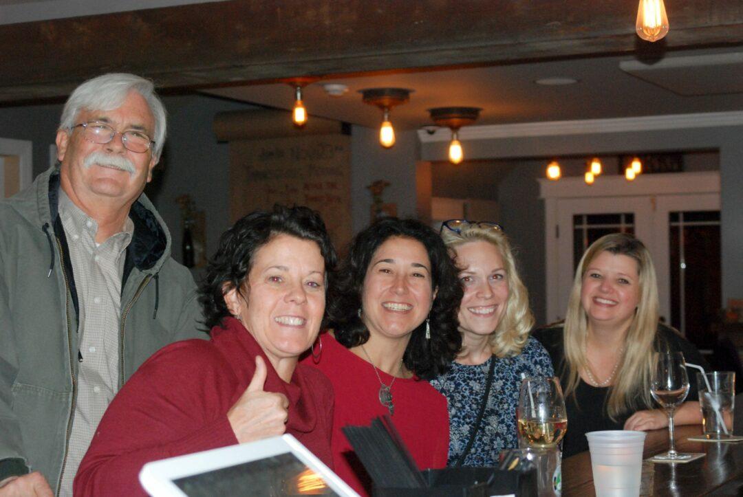 County Legislators Bill Reinhardt and Joanne Cunningham celebrate with newly elected Town Board member Maureen Cunningham  Photo: Ali Hibbs / Spotlight News