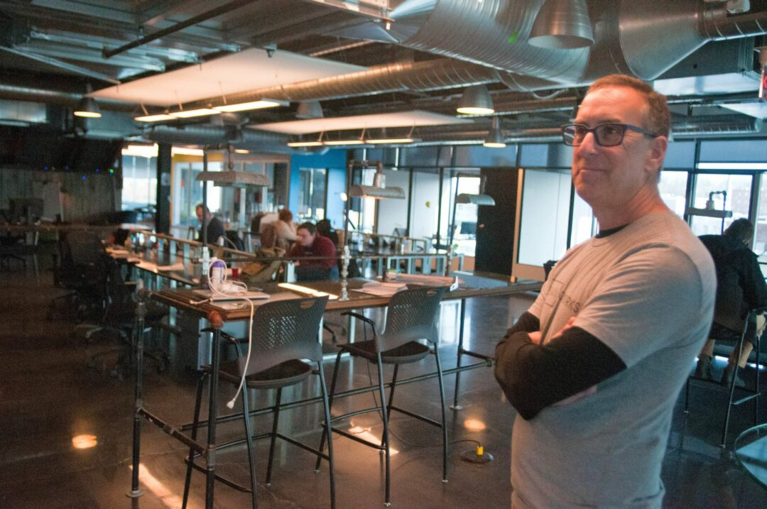 Jeff Goronkin, CEO of Urban Co-Works, stands in front of a growing business trend. Photo by Michael Hallisey / TheSpot518