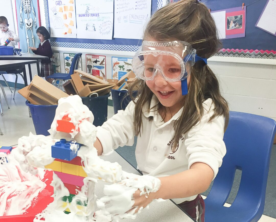 Kathleen Clark, Kindergarten student, building a castle in the clouds after reading Jack and the Beanstalk during a STEM in Fairy Tales unit.