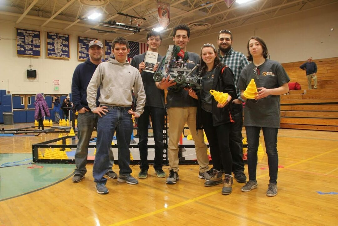 L-R: Mr. Kevin Shannon with winning team members Lance Tamchin, Luke Andres, Christian DeFranco, Molly Bogardus, Mr. Eric Fana, Abby DeFranco.                    Photo by Stephen DeFranco