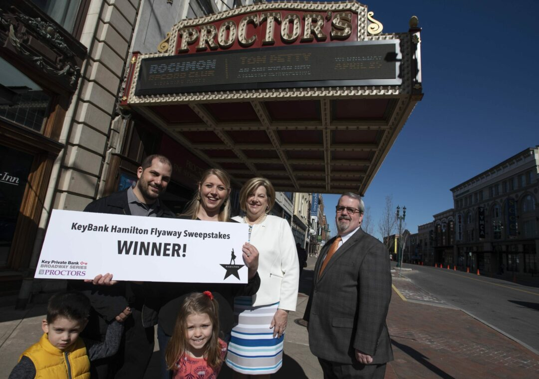 KeyBank Hamilton Flyaway Sweepstakes winner Nicole Consiglio, center, of Voorheesville with her husband Steve and their children Olivia and Vinnie pose with Fran O'Rourke, market leader, Capital Region, Key Private Bank and Dan Hanifin, relationships director at Proctors Monday, April 23, 2018. Nicole is the winner of an all expenses paid trip to Chicago to see Hamilton.